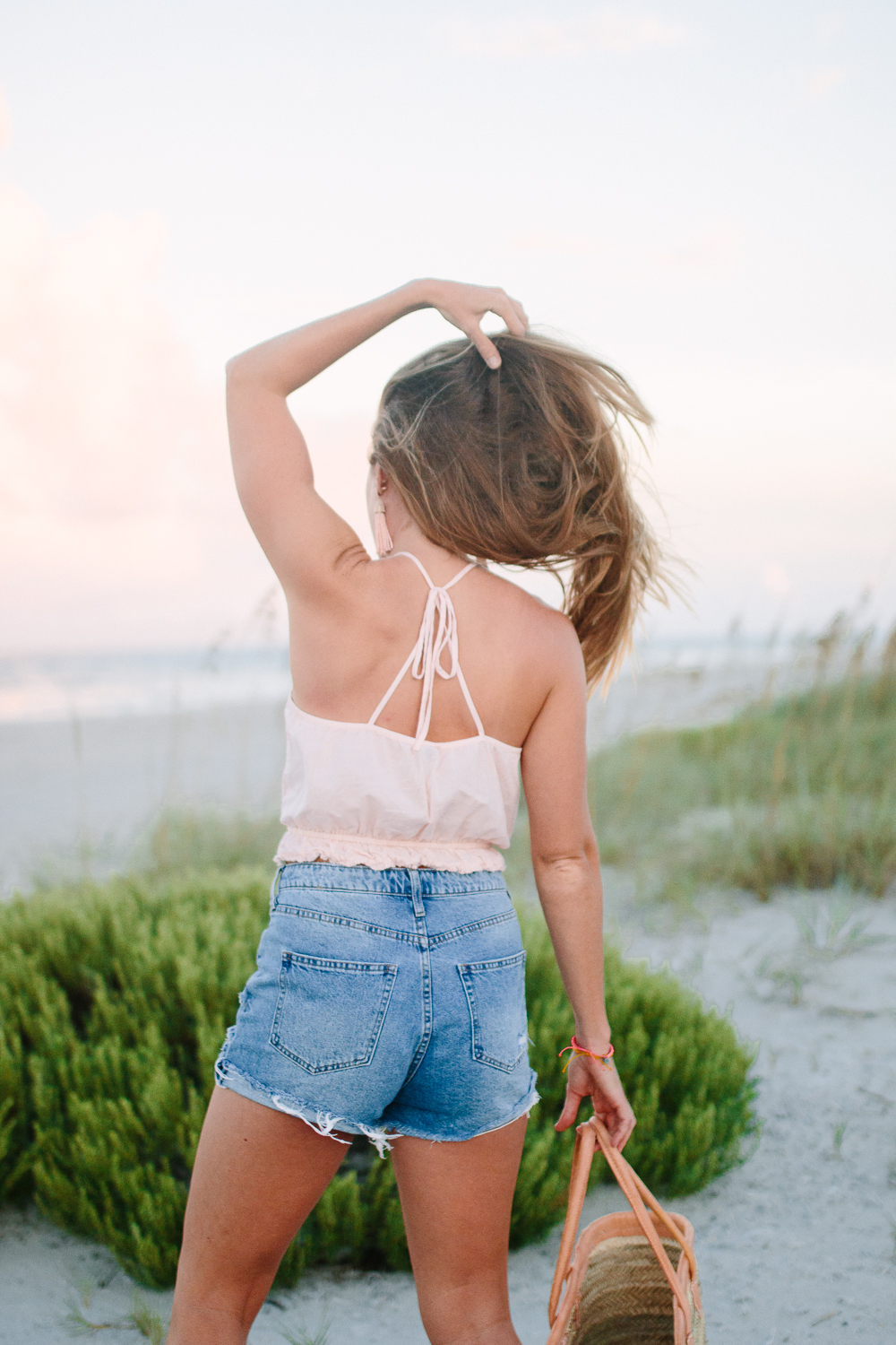 What to Wear to the Beach: A Casual Summer Outfit featuring an Aerie Crop Top, H&M High Waist Denim Shorts and Straw Beach Bag