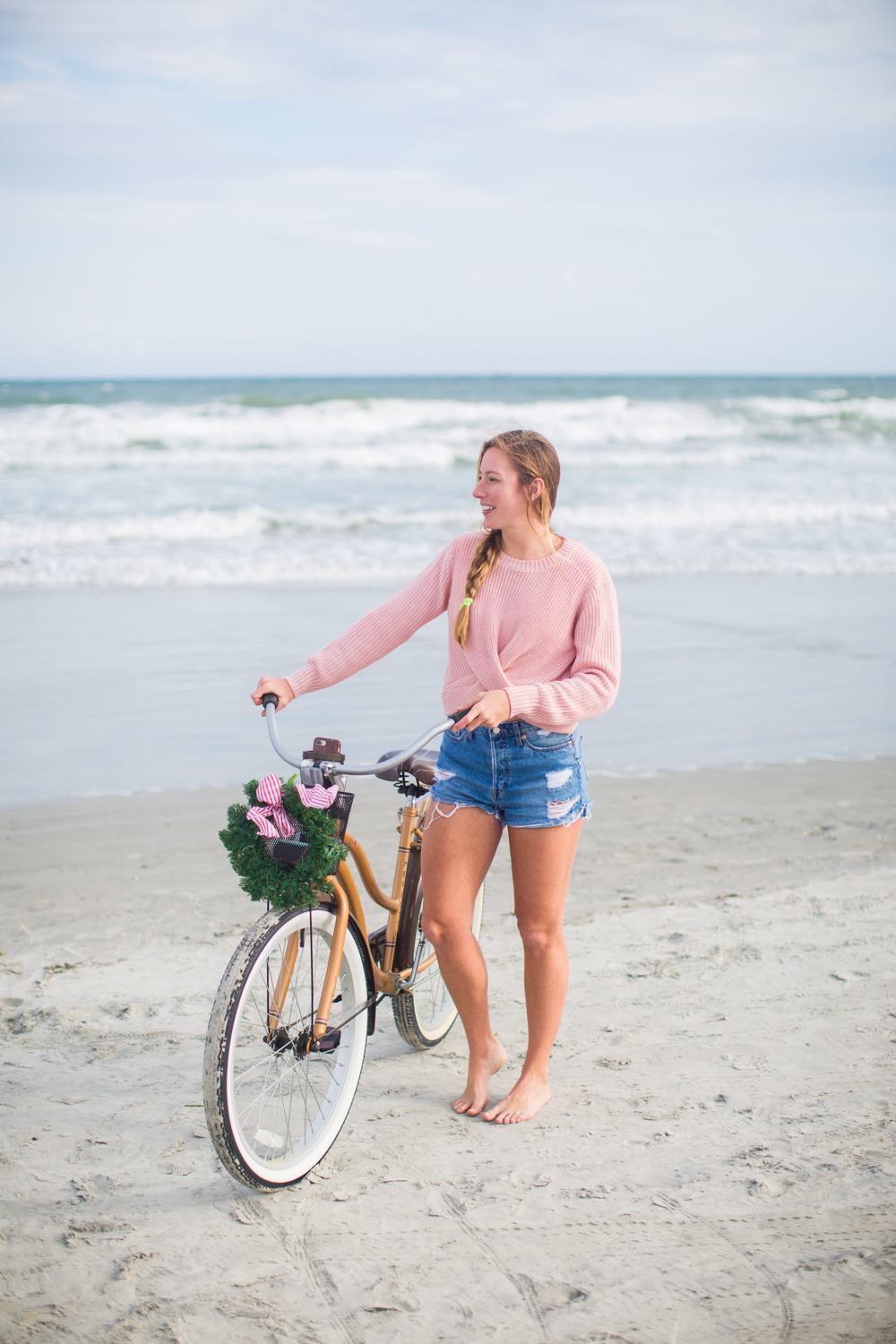 Sweaters to Wear During the Holiday Season | Beach Bike Ride | Winter Outfit Ideas | Christmas in Florida | Beach Bike Ride | Cropped Pink Sweater | Twisted Back Sweater | Winter Sweater Outfit
