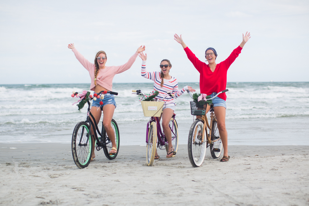 Sweaters to Wear During the Holiday Season | Beach Bike Ride | Winter Outfit Ideas | Christmas in Florida | Beach Bike Ride | Cropped Pink Sweater | Twisted Back Sweater | Red Knit Sweater | Striped Sweater
