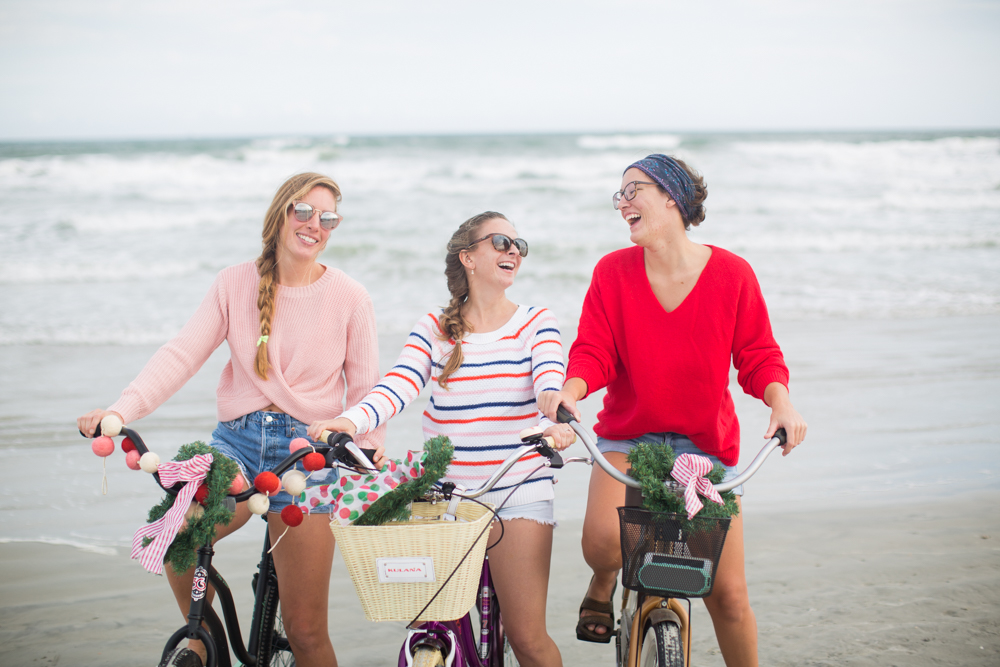 Sweaters to Wear During the Holiday Season | Beach Bike Ride | Winter Outfit Ideas | Christmas in Florida | Beach Bike Ride | Cropped Pink Sweater | Twisted Back Sweater | Red Knit Sweater | Striped Sweater | Friends on a Bike Ride