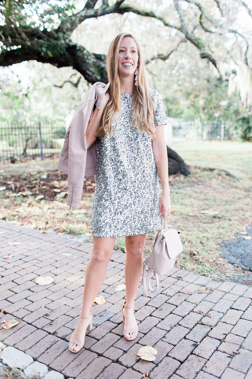 Sequin New Years Eve Dresses // What to Wear on New Years // New Years Eve Outfit Ideas // Sparkly Dresses // New Years Party Dresses // Pink Leather Jacket // Nude Block Heels // More on www.sunshinestyleblog.com #nye #nyedresses #nyedress #dresses #partydress