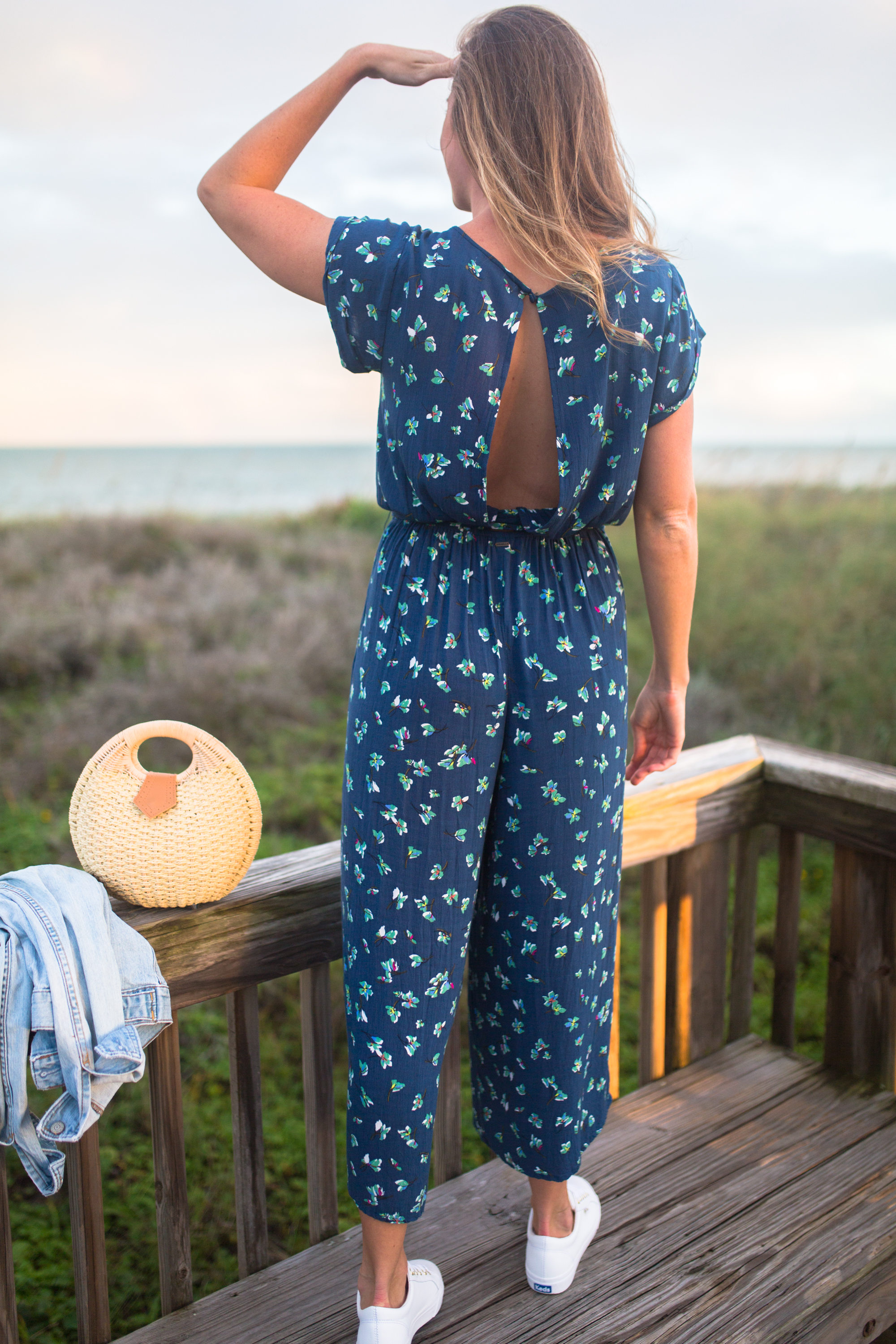 What to Wear on a Tropical Winter Getaway / Blue Floral Jumpsuit / Beach Resort Outfits / Resort Vacation Outfits / Vacay Outfits / Island Outfits Tropical / Beach Weekend Outfit / White Sneakers Outfit - Sunshine Style, A Florida Based Fashion and Lifestyle Blog