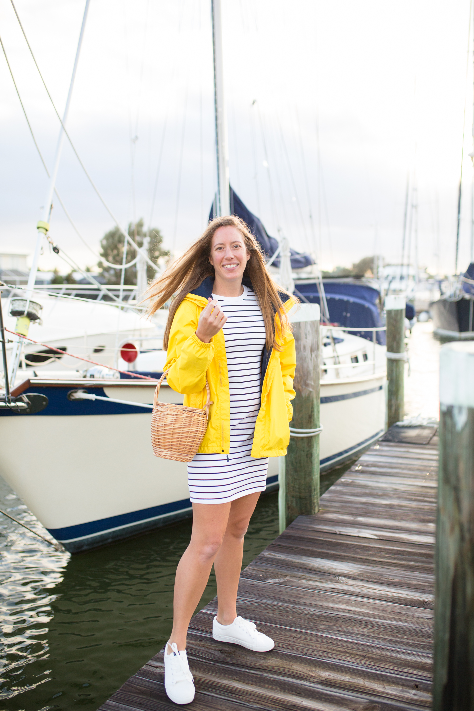 How to Style a Long Sleeve Striped Dress / Striped Dress Outfit / Blue Stripes / Yellow Raincoat / White Sneakers / Preppy Outfit / Coastal Outfit / Preppy Style Outfit / Cute Preppy Outfits / Nautical Outfit Women - Sunshine Style, A Florida Fashion and Lifestyle Blog
