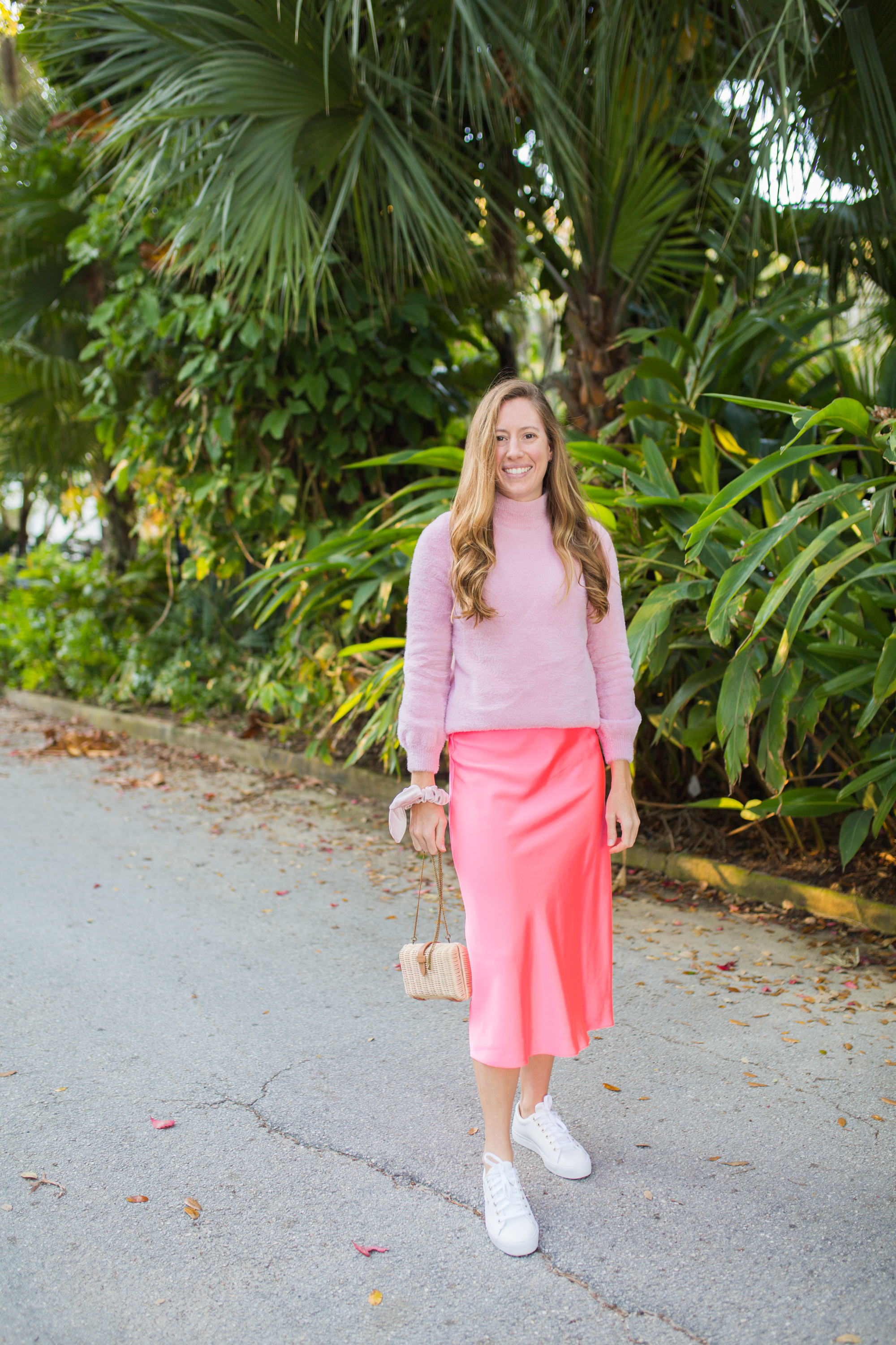 Colorful Monochromatic Winter Outfit / Winter Brights outfit / pink monochromatic outfit / bright colored outfits / pop of color outfits / silk slip skirt / white sneakers / valentines day outfit / straw bag - Sunshine Style, A Florida Fashion and Lifestyle Blog
