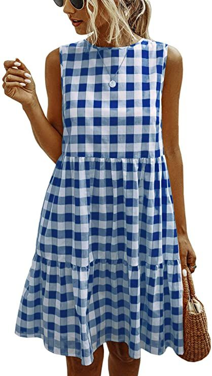 woman wearing a gingham dress, a bag, and wearing sunglasses