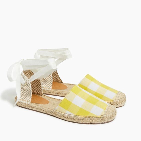 a pair of shoes for spring with yellow gingham print