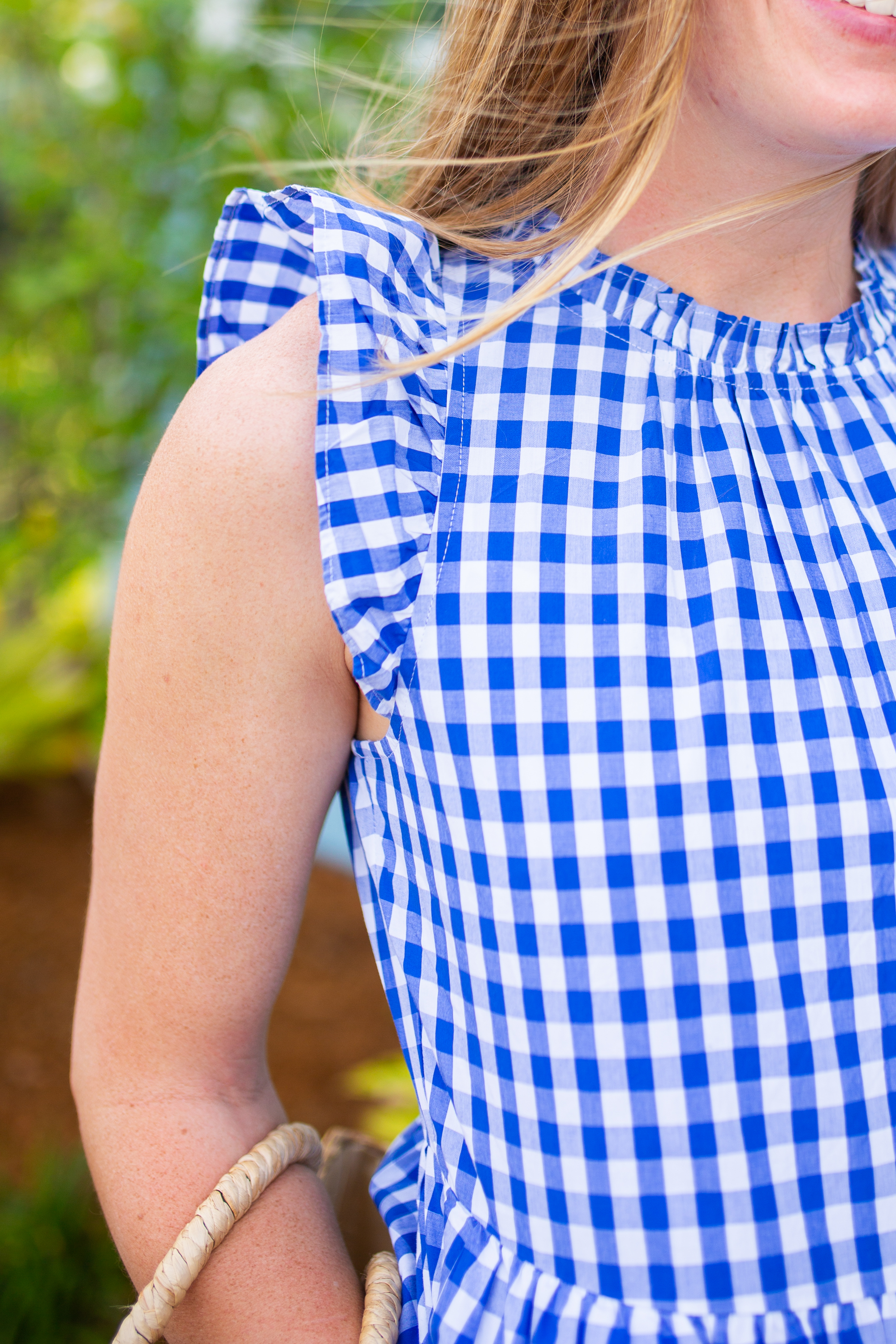 details of the J.Crew Gingham Tiered Dress in blue