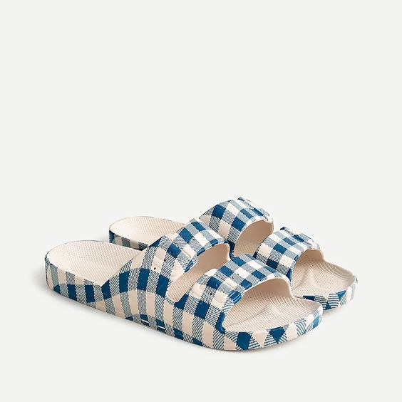 a pair of sandals with blue gingham print