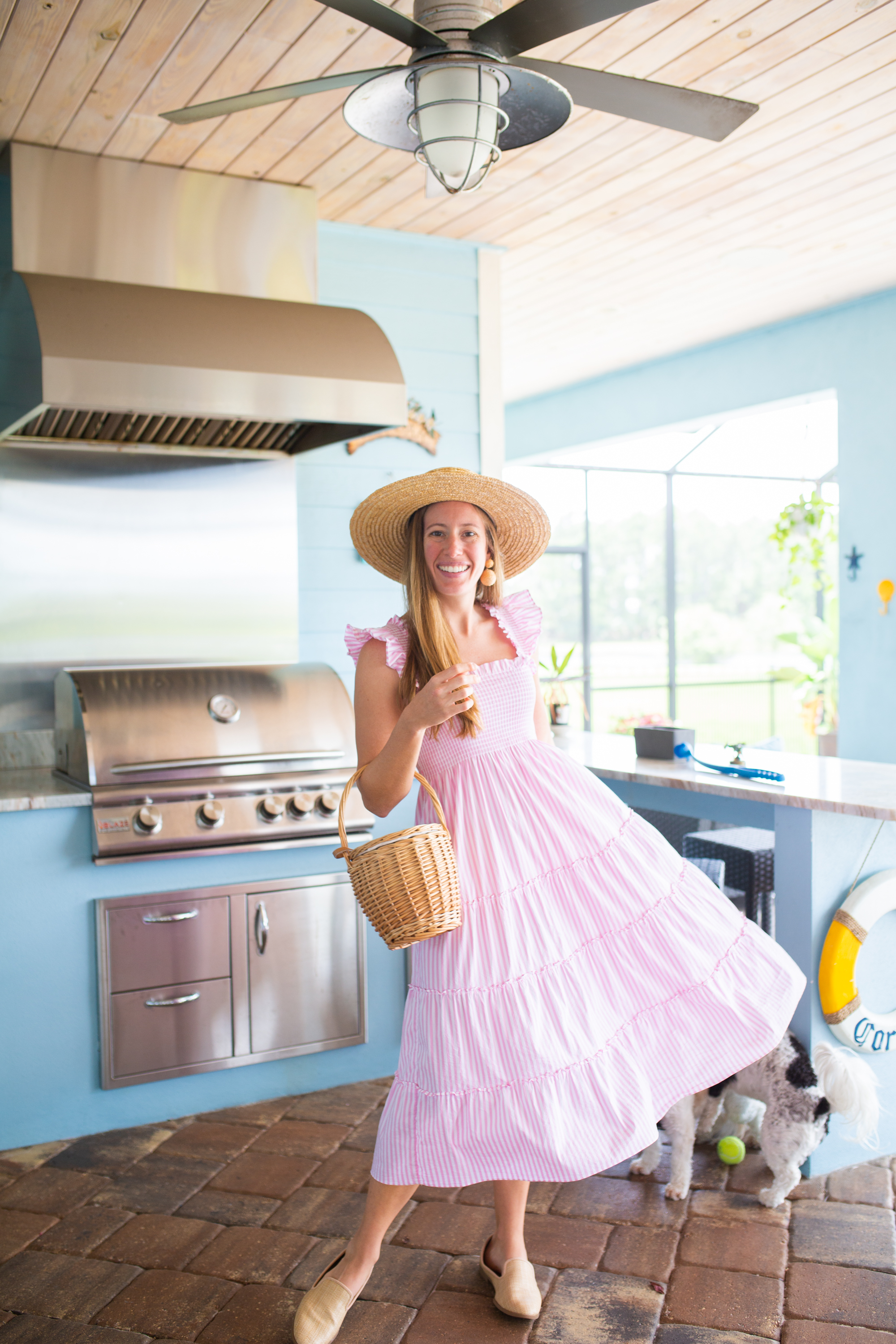 woman in the kitchen wearing pink dress and a hat for Nap Dress Review