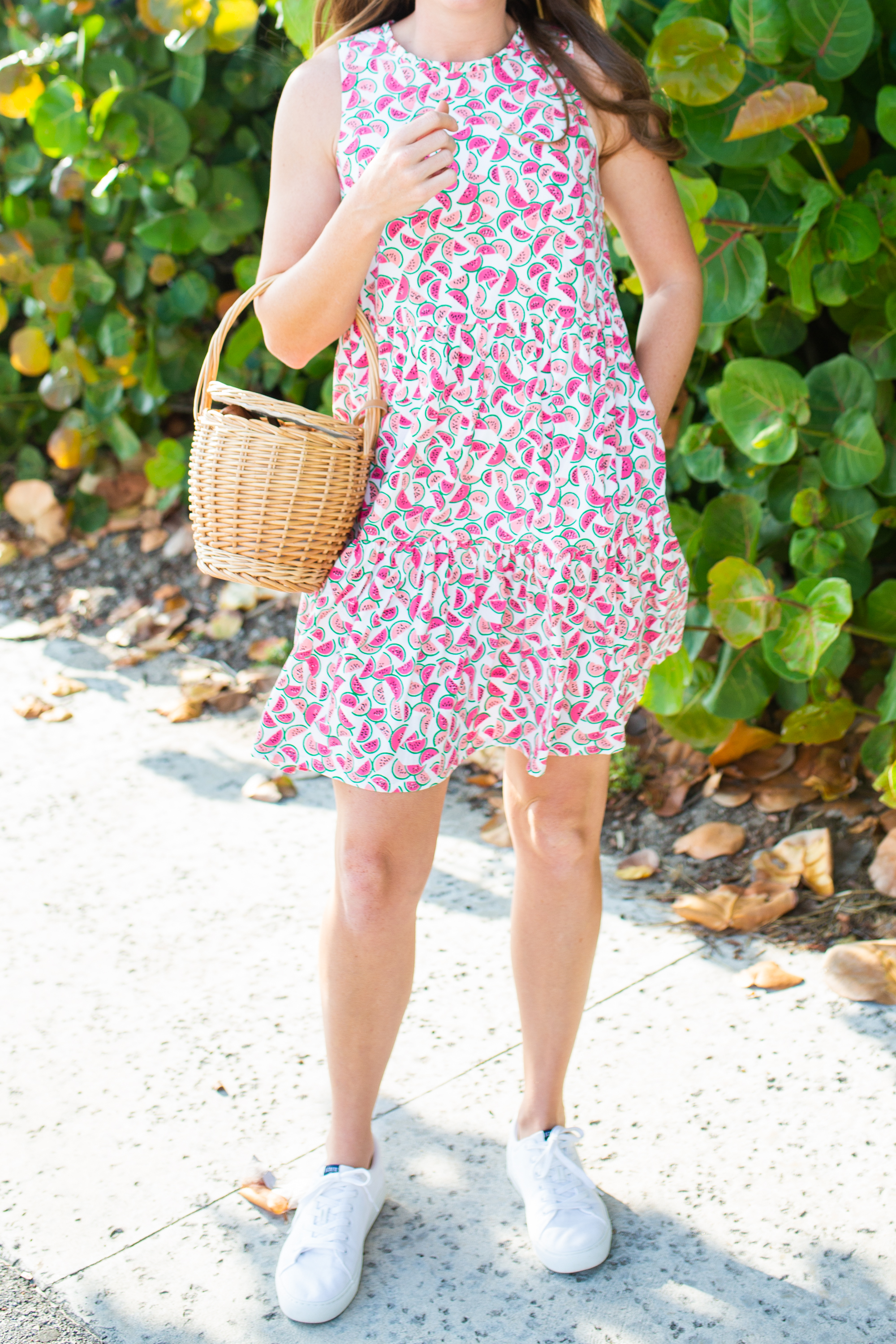 woman in outdoors wearing Citrus Print Pieces dress and white sneakers