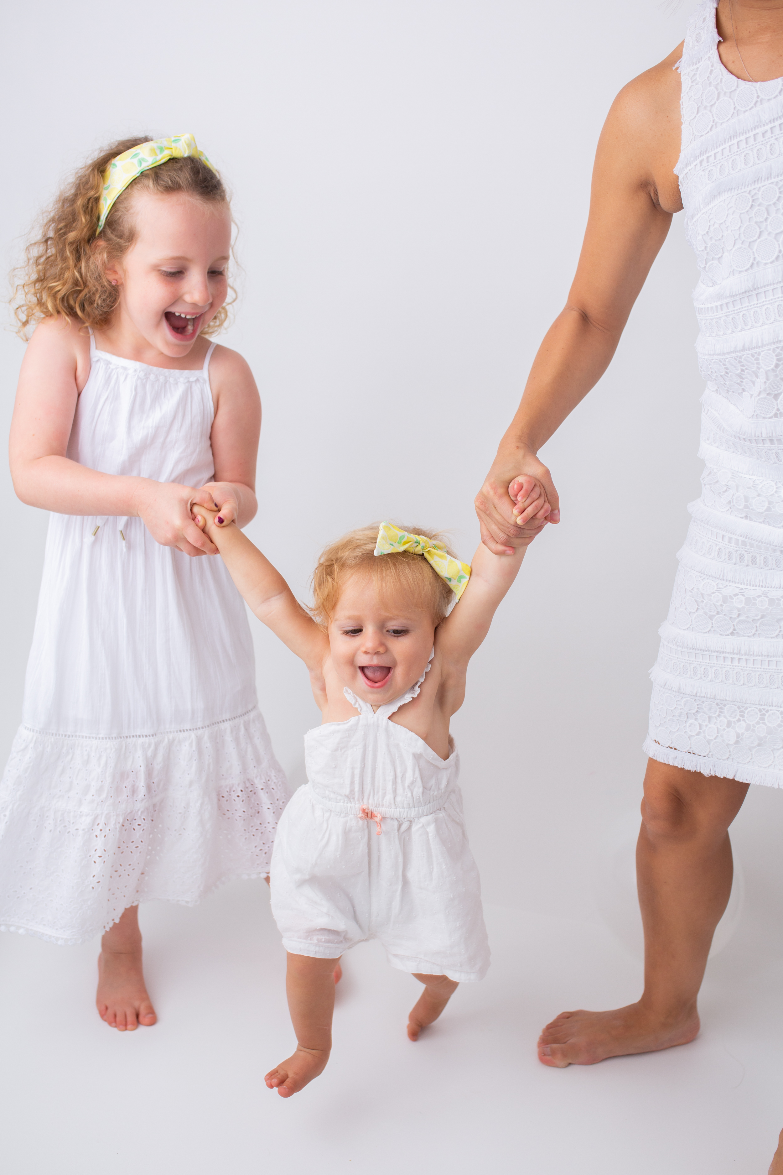 mom and kids wearing white dresses and Sunshine Style Headbands