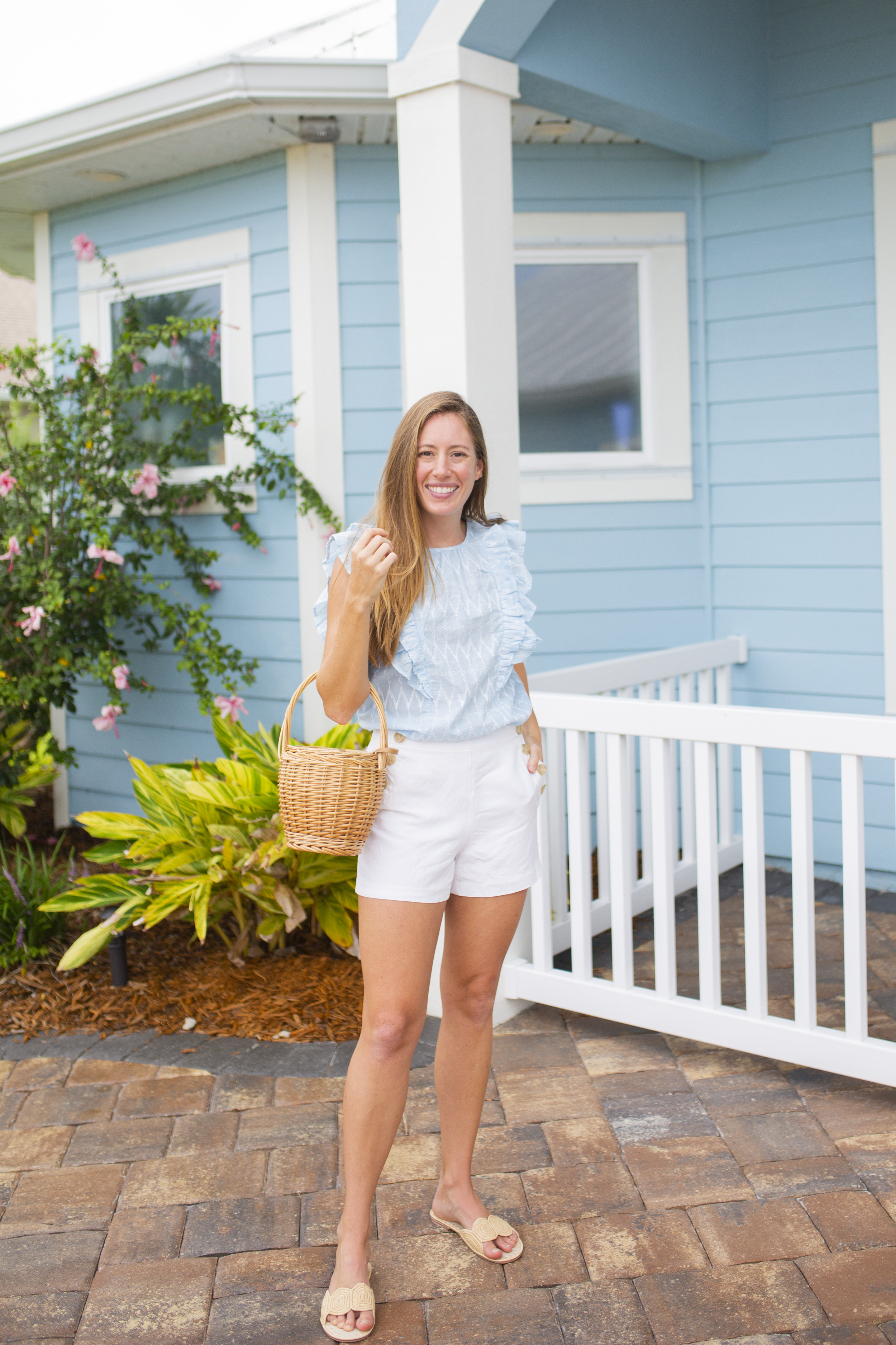 woman wearing blue and white combo for an end of summer outfit!